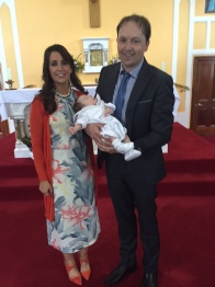 Rúan Francisco Pio Casey with is parents Ruth and Enda on his baptism day.